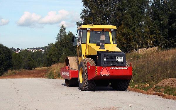Eco-Friendly soil and aggregate binder that creates a hard pavement surface and controls dust for road and pathway construction